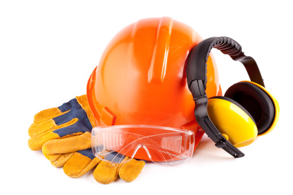 Orange hard hat, earphones, goggles and gloves on a white background